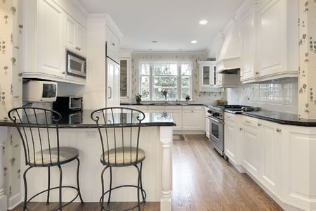 Kitchen in suburban home with white cabinetry Stock Photo - 6738608