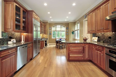 wood floor: Kitchen in upscale home with wood cabinetry