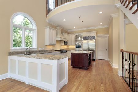 island: Kitchen in new construction home with balcony