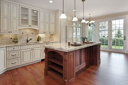 Kitchen in new construction home with cherry wood island