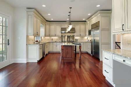 Kitchen in new construction home with cherry wood floor photo