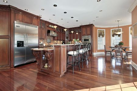 modern dining room: Kitchen in new construction home with cherry wood cabinetry
