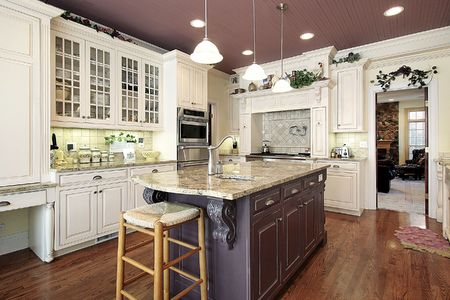 kitchen island: Kitchen in luxury home with white cabinetry Stock Photo