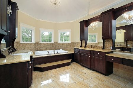 fixtures: Master bath in new construction home with dark wood cabinetry