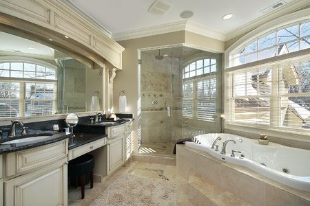 master bath: Master bath in luxury home with glass shower