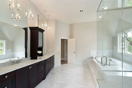 bathroom interior: Master bath in new construction home with dark wood cabinetry