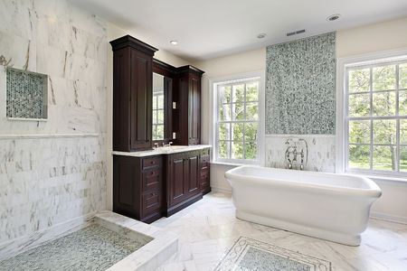 Master bath in new construction home with white tub photo