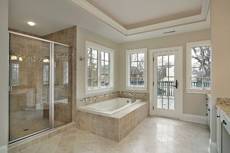 bathroom interior: Master bath in new construction home with glass shower
