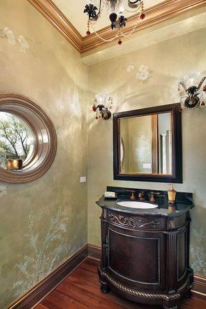Powder room in luxury home with rounded window photo