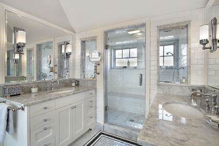 Master bath in luxury home with windowed shower Stock Photo