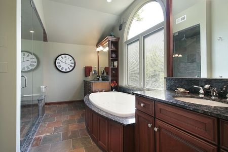 master: Master bath with multicolored flooring and glass shower