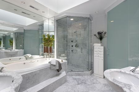 fixtures: Upscale master bath with marble sink and tub Stock Photo