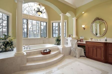 bathroom interior: Master bath with columns and step up tub Stock Photo