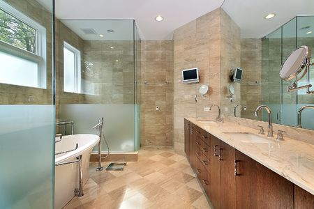 Modern master bath in luxury home with glass shower photo