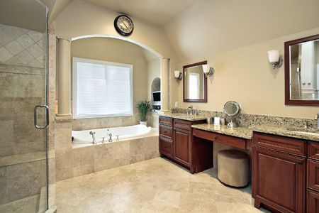 Master bath in luxury home with tub columns