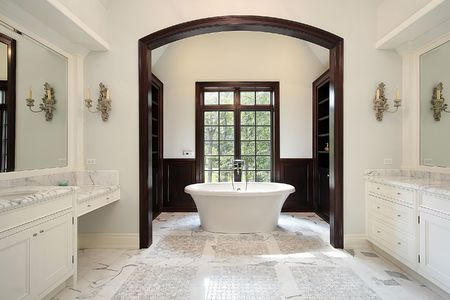 Master bath in luxury home with arched tub area Stock Photo