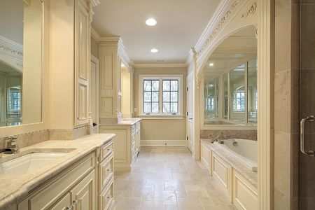 Master bath in new construction home with mirrored tub Stock Photo - 6738280