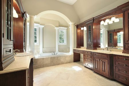 Master bath in luxury home with white tub columns Stock Photo - 6738335