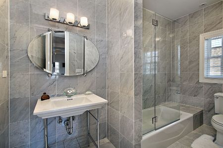 Master bath in luxury home with gray tile