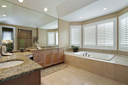 Master bath in luxury home with granite counters