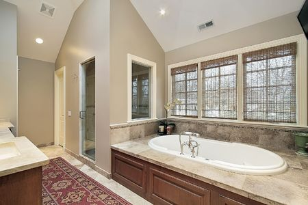 Master bath in luxury home with wood paneled tub Stock Photo - 6738811