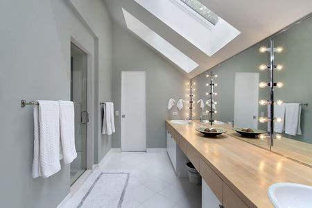 Master bath in luxury home with skylights photo