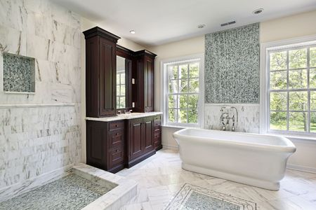 Master bath in luxury home with large white tub photo