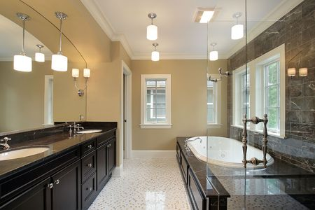 fixtures: Master bath in new construction home with black tub area Stock Photo