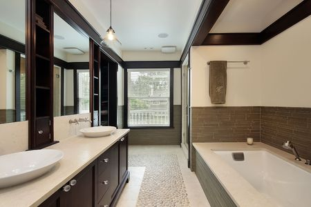 bathroom interior: Master bath in luxury home with dark wood trim Stock Photo