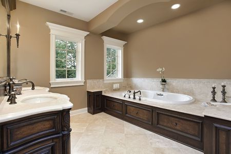 cabinetry: Master bath in new construction home with dark wood cabinetry