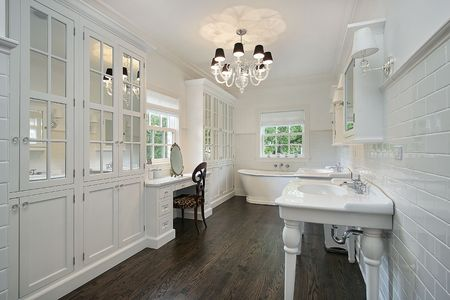 bathroom interior: White master bath with dark wood floors