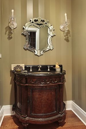 Powder room in luxury home with oval sink photo