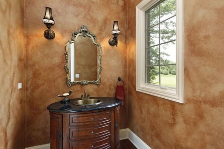 powder room: Powder room in luxury home with oval sink