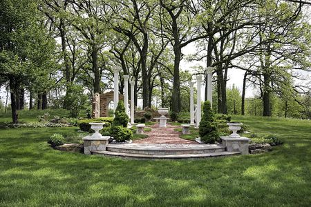 Grounds of luxury home with pillars and stone steps photo