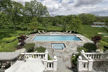 expansive: Expansive view of deck pool and grounds of mansion