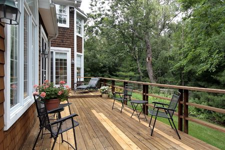 residential: Large wood deck with forest in luxury home Stock Photo