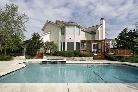 single family house: Swimming pool and deck at large luxury home  Stock Photo