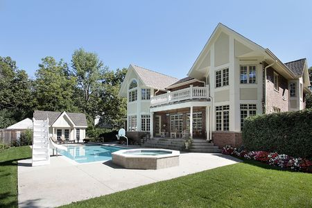 luxury home: Rear view of luxury home with swimming pool