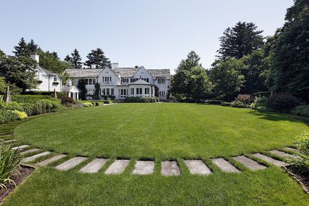 Back yard of luxury home with stone path photo