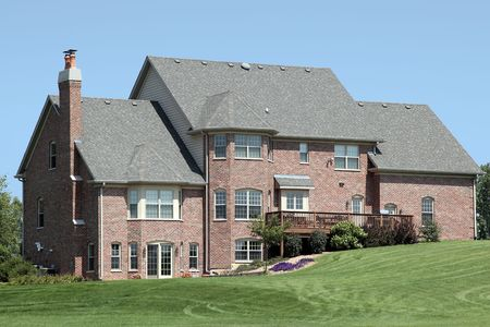 Rear view of large brick home with deck Stock Photo - 6739895
