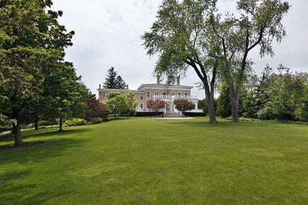 Large back yard of luxury suburban home photo