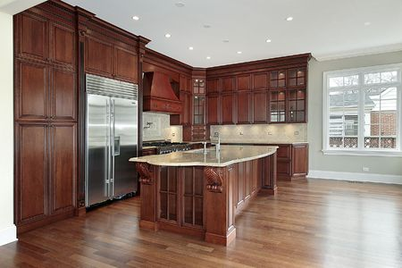 Kitchen in new construction home with cherry wood cabinetry photo