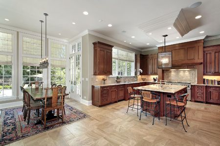 Large kitchen in luxury home with eating area Stock Photo - 6739775