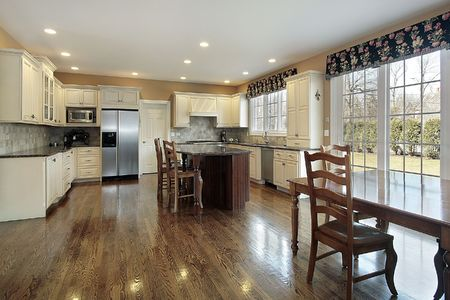 Kitchen in suburban home with eating area photo