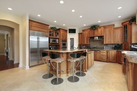 Kitchen in luxury home with bar stools photo
