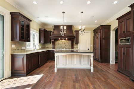 Kitchen in new construction home with white island photo