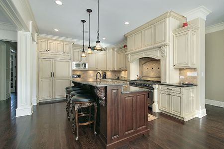 Kitchen in new construction home with marble island Stock Photo
