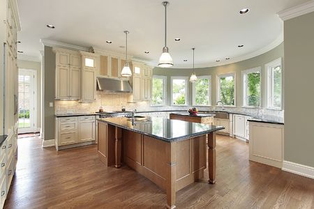 lighting fixtures: Kitchen in new construction home with curved walls