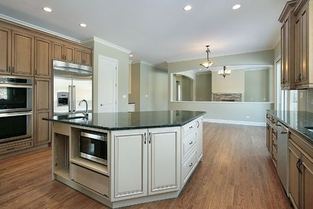Kitchen in new construction home with family room view photo