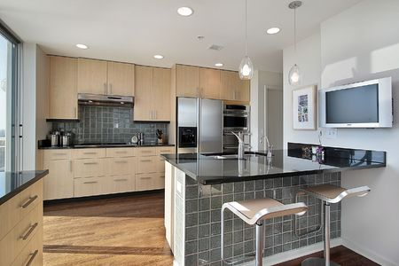 Kitchen in contemporary condo with granite island Stock Photo